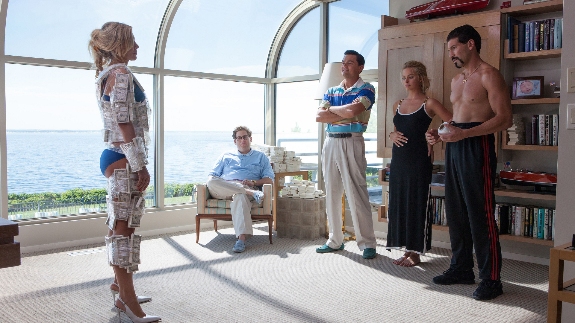 Center left to far right: Jonah Hill plays Danny, Leonardo DiCaprio plays Jordan Belfort, Margot Robbie plays Naomi, and Jon Bernthal plays Todd in THE WOLF OF WALL STREET, from Paramount Pictures and Red Granite Pictures.